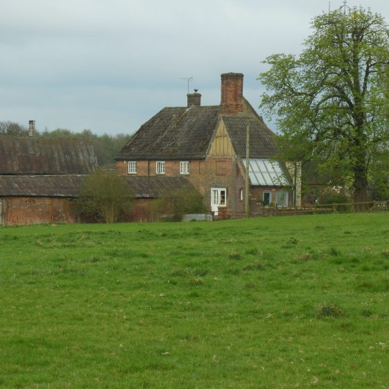 6. Zouches Farm from the west, nestling in the valley which passes through the farm-buildings. | R Ross, April 2014