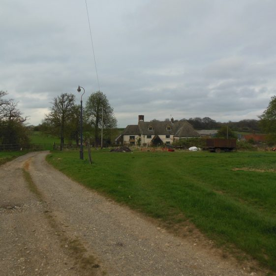 8. Zouches Farm from the south, with Grove Spring on the left. The valley passes 'horizonally' behind the farm. | R Ross, April 2014