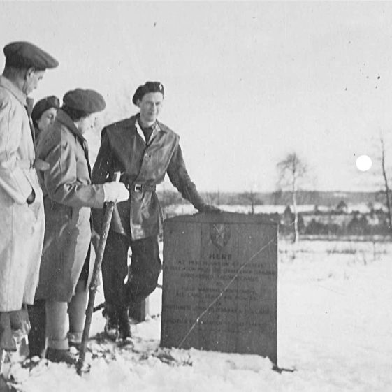 Team members at the temporary monument at the scene of German surrender on Luneburg Heath, winter 1946 | Vol.2 - page 47