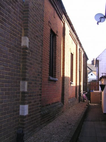 The original 1865 chapel still visible in the side elevation | David Noble
