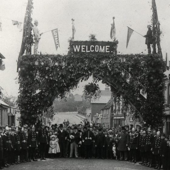 Station Road - Welcome to Duke of Clarence - Ridley's on left - 1890's.  Click on this photo for a link to Royal events in Harpenden. | Cat no Slides B 1.53