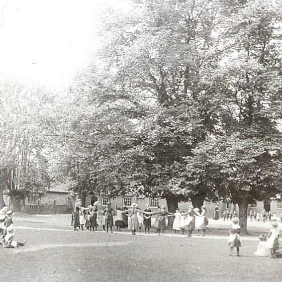 British School, girls playing on common, boys on playground - 1890's (now Park hall)   Cat no  Slides B 1.59