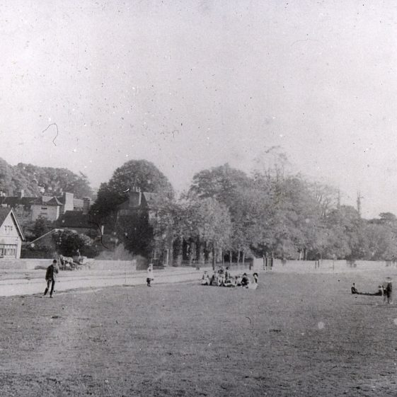 The Institute -1890's - with 'lads & lassies' playing on The Green.  Became Friends Meeting House in 1930s | LHS archive, cat.no. B 2.40