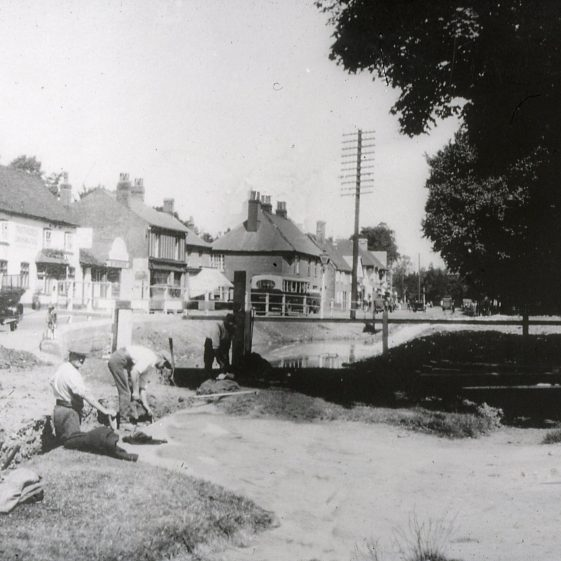 Draining the Cock Pond - 1927/8.  View to Cock Inn and 68-72 High Street | Cat no Slides B 2.61