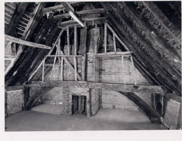 2 Southdown Road - Chamber over the Hall, with smoke-blackened central open truss and collar-rafter couples. A chamfered square-section crown-post has empty mortice for brace to the purlin, and sits on an arch-braced tie-beam. Behind the truss, C19 framing for a partition and brick chimney with hearth. | RCHM 1975