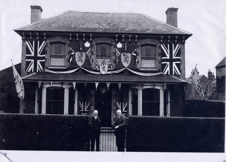 The MacDonald brothers at the gate of 29 Station Road, decorated for the Silver Jubilee in 1935 | LHS archives