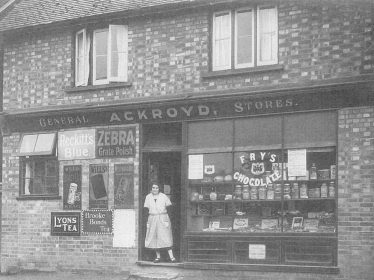 The Shop at Batford. Ernest's future wife Olive can be seen standing in the doorway, c1924   The Village Baker by Geoff Ackroyd