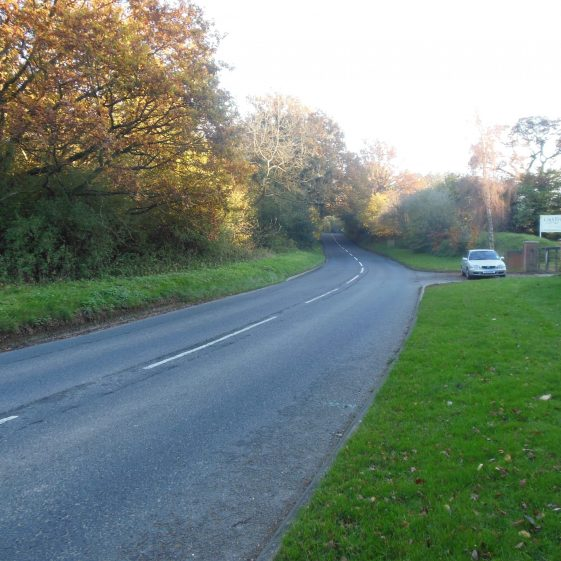 14. Chaul End Road, entrance to Caddington Golf Club - looking South - the valley crosses the road, through the hedgerow, towards Badgerdell Wood. | R Ross, October 2015