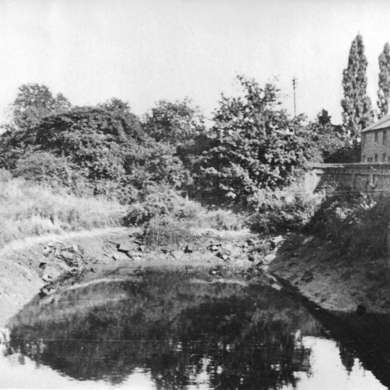 76. To alleviate the risk of flooding, Harpenden Urban District Council excavated and deepened an old gravel pit at the end of Dark Lane to form a deep sump | LHS archives - LHS 012139
