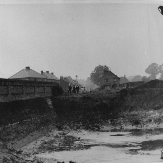 77. The deep pool is still there behind the wall in Grove Road. During WWII a hatch was cut through the roadside wall, with a door labelled 'E.W.S.': this was an emergency water supply for the Auxilliary Fire Brigade. The hole was still there in 1962. | LHS archives - LHS 012139