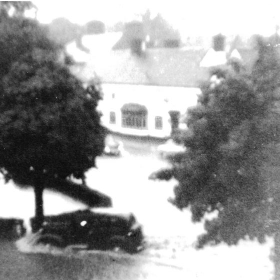 60. Concrete barriers were built around the Cock Pond, as road traffic increased, but did not solve the problems.  Heavy storms overwhelmed the new culvert in 1936 and 1937 | LHS archives - EB High Street North album