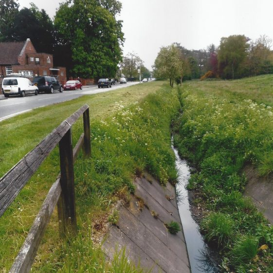 65. The drainage channel emerging from the outflow pipe from Harpenden Lower High Street | LHS archives - L Casey