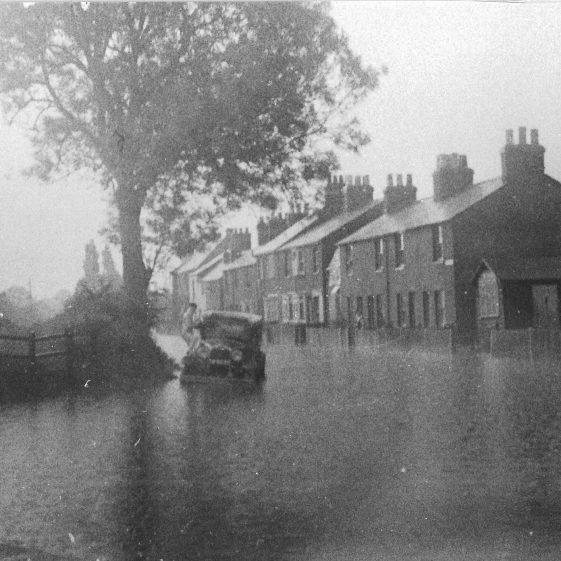 75. On 21 June 1936, storm waters from the sides of the valley caused deep flooding in Grove Road - here at the corner with Piggottshill Lane | LHS archives - LHS 000967