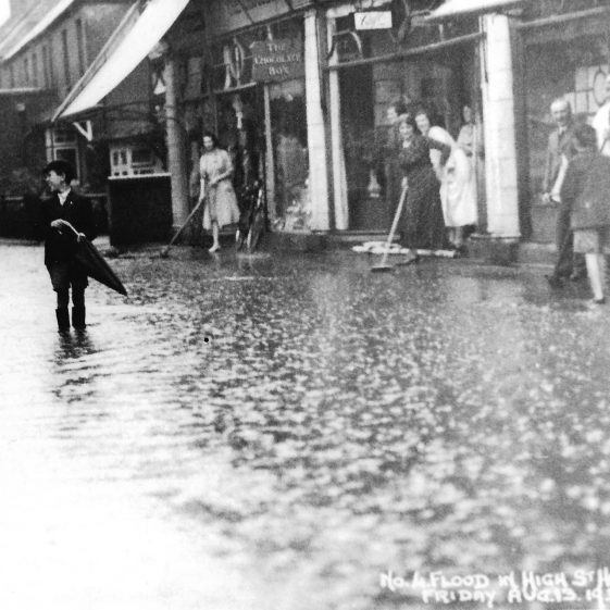 62. Clearing up in Lower High Street, after a storm on 13 August 1937 | LHS archives - LHS 002893