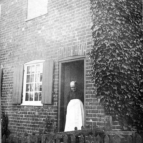 Mrs Munt at the backdoor of 30 Batford Road, 1920s   Di Castle's family albums