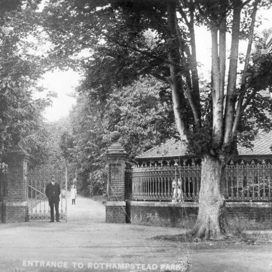 Gates to Rothamsted Park with lodge cottage, c.1900, next to British School/Public Hall.  The gates and railings were removed in WWII   LHS archives, cat. no.HC 026