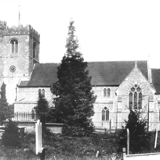 St Nicholas Church with table grave in churchyard - after re-building | Cat no HC 080