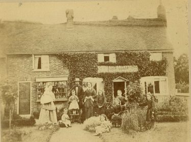 Henry Salisbury and his family outside their home in Leyton Road, 1876. Frank is the toddler on the front row, left. | LHS archives