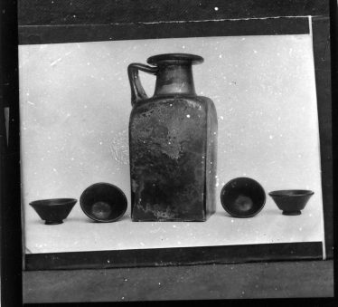 Green glass burial jar and Samian ware dished.  Now in British Museum