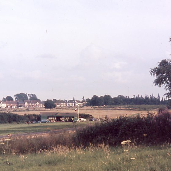 Harpenden Common, viewed from Leyton Road, across the cricket pitch to Queen's Road and East Common, 1960s   LHS archives, JJ 030