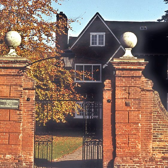 Gates of Harpenden Hall - UDC office, pre 1974. Note that the wrought iron arch with lamp does not have 'Harpenden Hall' inscription.   LHS archives - JJ 039