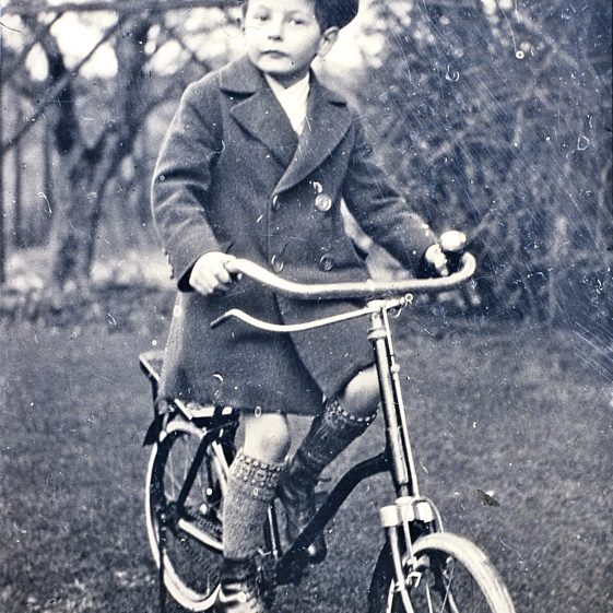 JMJ on bicycle in Gorselands garden - 1999 from 1920s photo | LHs archives - JJ 176