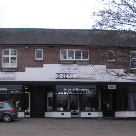 Snips ladies and gents hairdressers, Leyton Road - with Herts Dental Practice   R Ross 2014