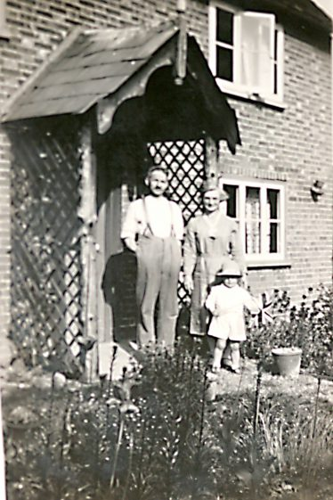 My grandparents & me at our cottage in Oggelsby's Yard | John Olley