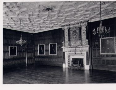 Rothamsted Manor, Great Drawing Room as remodelled by Sir Charles Lawes in 1900, with specially commissioned ceiling, fireplace and panelling.  Imagine this filled with 30 powerful radio receivers, working night and day. | Royal Commission for Historical Monuments c 1975, LHS collection