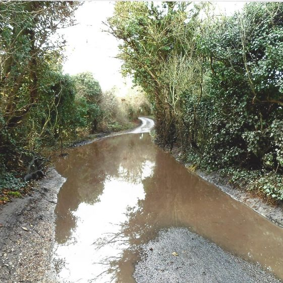 42. Kennel Lane floods frequently at a dip, east of the new lake | LHS archives, L Casey, Jan 2015
