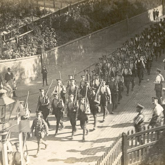 1. Arrival at Harpenden - Men of the 6th Battalion marching down Station Road, near Calton Bank, August 1914. Note the horse and cart going up the hill. | Michael Briggs - SF5-MB