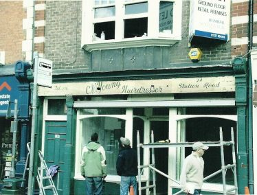 Young's hairdressers, 24 Station Road - sign revealed in 2006 | Les Casey, LHS archive cat.no. P.009595