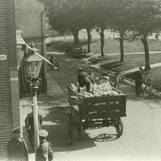 21.  Bread delivery cart in Lower High Street, Harpenden - men of N Staffordshire regiment and scout volunteers | LHS archives - SF 0020