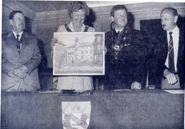 Cllr Mrs Dorothy Mills receiving a painting of Alzey old Town Hall from Burgermeister Walter Zuber, 1988 | LHS archives, Alzeyer Anzeiger, 19 May 1988